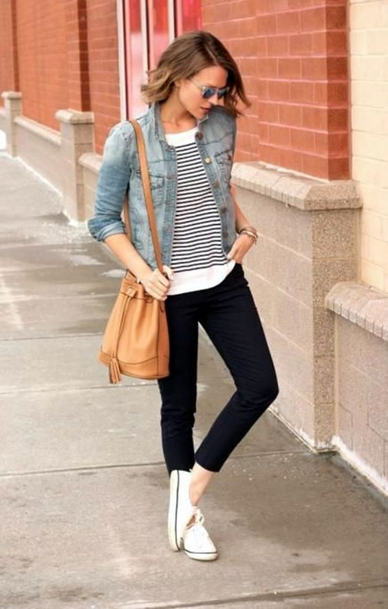 black cropped pants, a striped top, a denim jacket, white sneakers and a tan bag