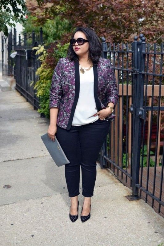 black skinnies, a white top, a bold printed jacket with black lapels and heels