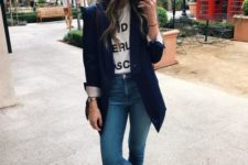 05 silver flat shoes, blue jeans, a printed tee, a navy blzer with cuffed sleeves