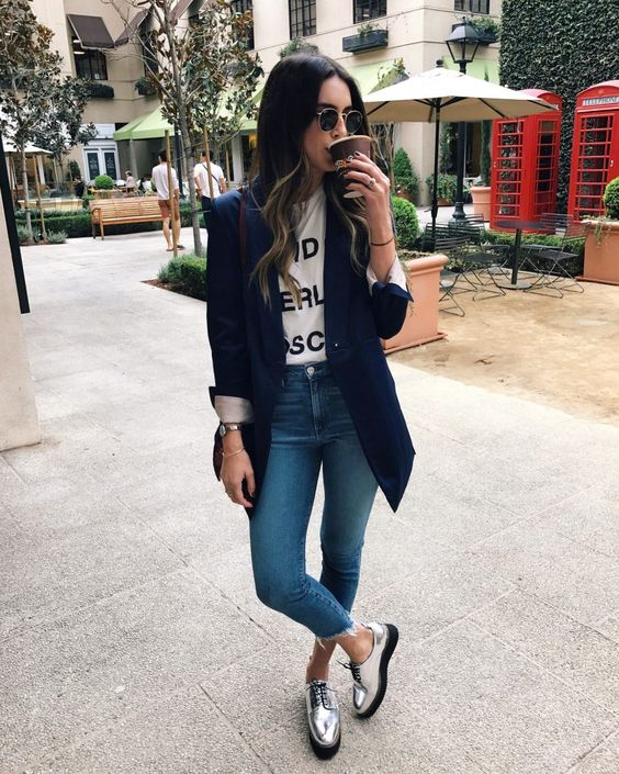 silver flat shoes, blue jeans, a printed tee, a navy blzer with cuffed sleeves
