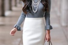 06 a creamy pencil knee skirt, a grey top with ruffled sleeves, layered necklaces