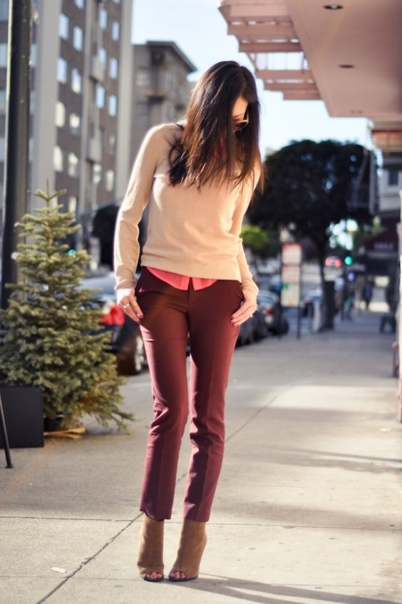 a pink shirt, burgundy trousers, tan peep toe booties and a blush sweater over the shirt
