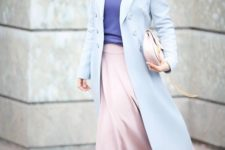 06 a powder blue coat, an ultra-violet top, a pink midi skirt, blue boots and a blush bag