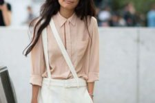 07 a blush shirt and creamy trousers with suspenders worn on one shoulder