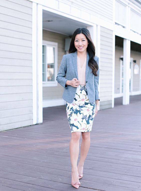 d2dce1f5e6a69 Picture Of a floral print pencil skirt, a blush blouse with ruches, blush  shoes, a grey jacket