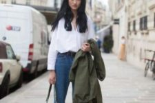 07 a white shirt, blue high waisted jeans, black sneakers and an olive green jacket