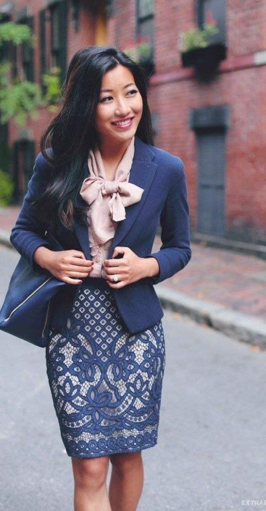 an embroidered navy and silver over the knee skirt, a blush blouse with a large bow and a navy jacket