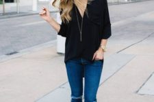 07 blue ripped skinnies, a black loose shirt and black heels for a casual and cool look