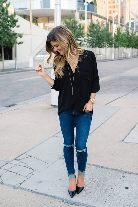 blue ripped skinnies, a black loose shirt and black heels for a casual and cool look
