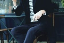 07 navy pants, black shoes, a striped long sleeve and a black coat for an edgy look
