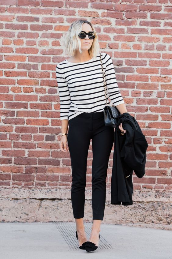 a black and white long sleeve top, black cropped pants, black and nude flats
