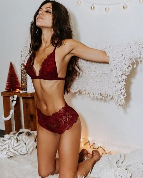 a burgundy lace lingerie set with high waist pants looks chic and boho