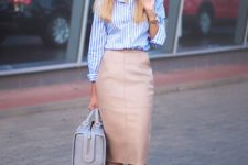 08 a nude leather midi pencil skirt, a blue and white striped shirt, pink slip-ons and a large bag