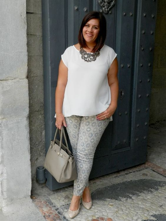 printed pants, a white top, a statement necklace, nude shoes and a grey bag