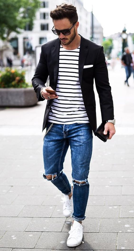 ripped jeans, a striped t-shirt, a black jacket and white sneakers