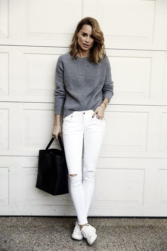 ripped white denim, a grey long sleeve, white sneakers and a black bag for a simple look