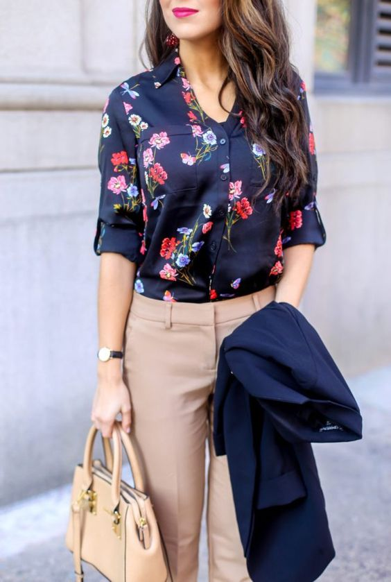 a classic floral blouse styled for the office with tan pants, a tan bag, a navy blazer