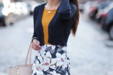 09 a floral print knee skirt, a mustard top, a cropped navy cardigan and a neutral bag