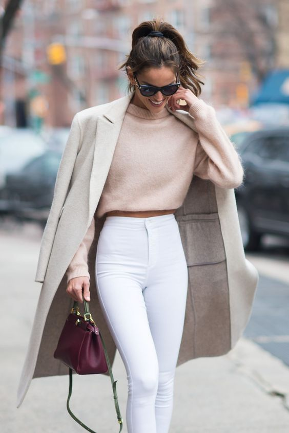 white high waisted jeans, a blush crop sweater, a neutral coat and a burgundy bag