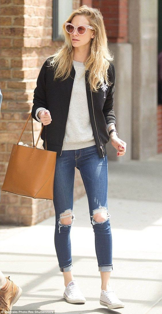 white sneakers, ripped and cropped jeans, a grey long sleeve, a black bomber jacket