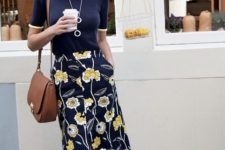 10 a navy floral print midi skirt, a navy top, a brown bag for a modest work look