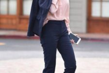 10 a navy pantsuit with cropped pants, a pink shirt and blue shoes for a professional look