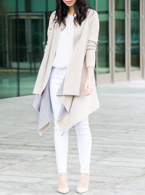a white top, white jeans, nude shoes and a tan asymmetrical coat for a neutral look