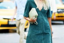 10 an emerald suede mini dress with a deep V-neckline and a light green clutch