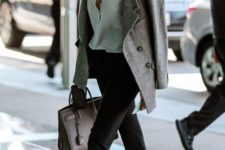 10 black pants, a muted green shirt, black flats, a grey short coat