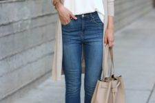 10 blue jeans, a white top, a tan long cardigan, tan peep toe booties and a matching bag
