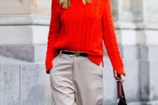 10 neutral wide pants, a red cable knit sweater and a comfy bag