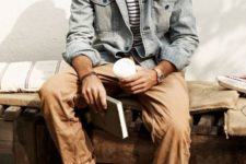 10 white sneakers, tan pants, a striped tee and a distressed denim jacket for a relaxed feel