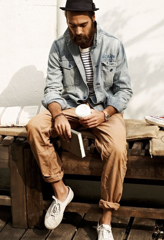 white sneakers, tan pants, a striped tee and a distressed denim jacket for a relaxed feel