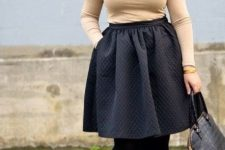 11 a black knee skirt, black tights, black shoes, a neutral top with long sleeves and a statement necklace