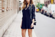 11 a black mini dress, a black leather jacket, metallic shoes and a striped bag