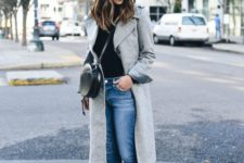 11 a black top, blue straight jeans, black chelsea boots and a grey coat
