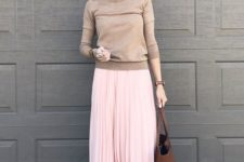 11 a casual and girlish look with a tan top, a pink pleated midi and flats