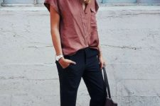 11 a dusty pink short sleeved shirt, navy pants, blush spiked flats and a large bag