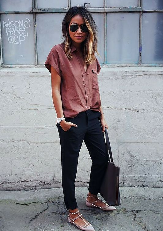 a dusty pink short sleeved shirt, navy pants, blush spiked flats and a large bag