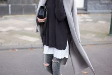 11 a white tee, a black sweater, a grey coat, grey ripped denim and black strappy shoes