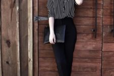 11 black pants, a striped black and white shirt, metallic platform shoes and a black clutch
