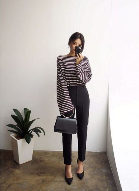 black trousers, a black and white striped top with long bell sleeves, black heels and a bag can be even worn to work