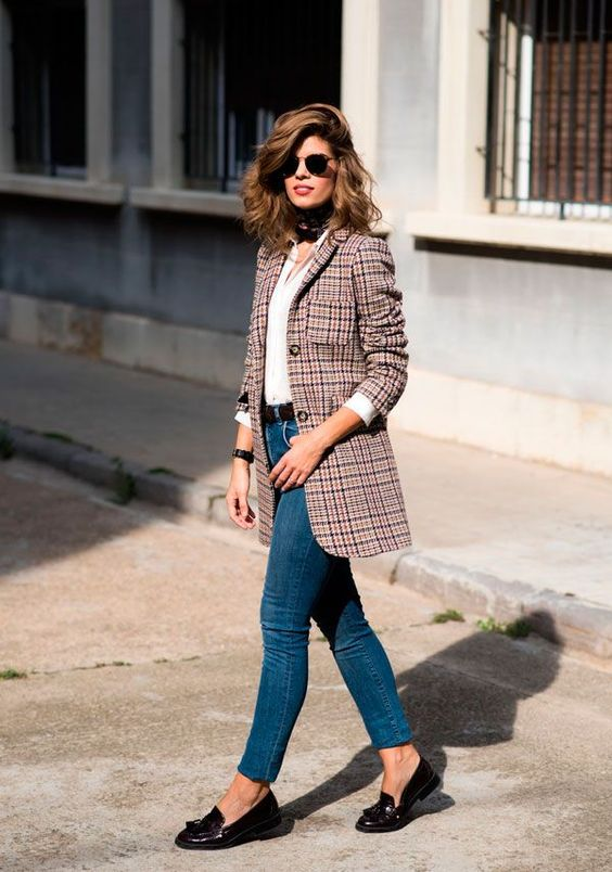 blue jeans, a white shirt, a long checked blazer and black moccasins can be worn to work