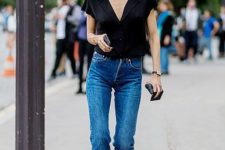 12 a black V-neck top, blue straight jeans, black heels and a small bag for a laconic look