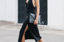 12 a black slip dress with a plunging neckline and a side slit, high heels and a chocker