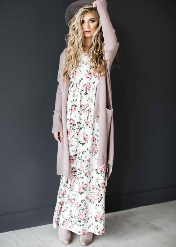 a floral maxi dress, a long blush cardigan, matching boots and a hat for a boho relaxed look