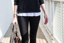 12 black pants, a white tee, a black long sleeve, black slip-ons and a black bag