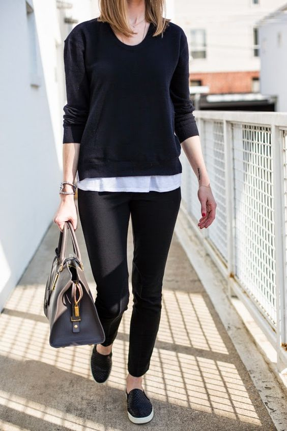 black pants, a white tee, a black long sleeve, black slip-ons and a black bag