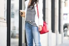 12 blue distressed cropped skinnies, a black and white top, a white blazer, red shoes and a bag