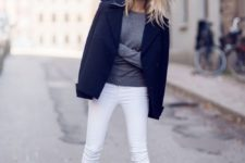 12 white jeans, black shoes, a grey sweater and a short black coat